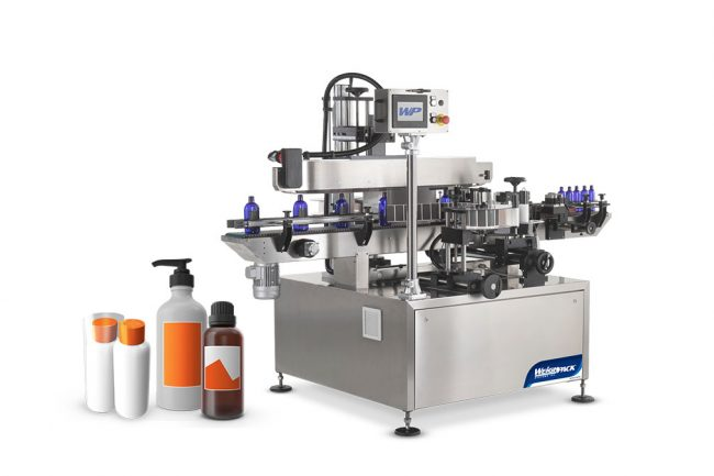 Bottle labeling and sleeving machine